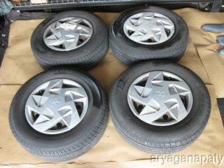 95 99 Mitsubishi eclipse OEM wheels rims w/ tires and hub caps STOCK