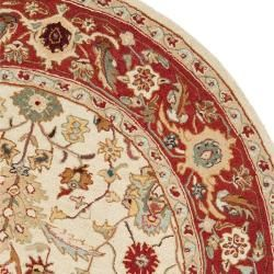 Hand hooked Tabriz Ivory/ Red Wool Rug (56 Round)